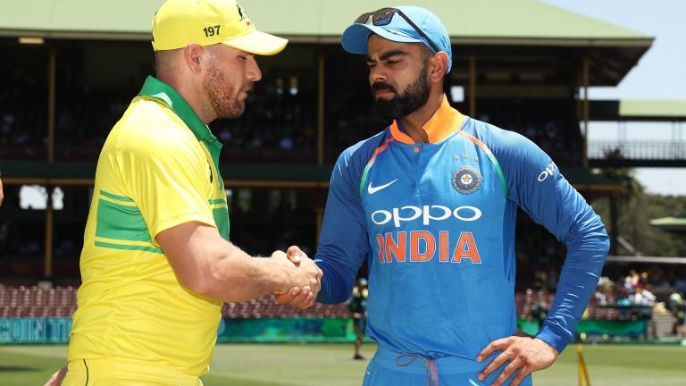 Virat Kohli (right) shakes hands with Australia captain Aaron Finch