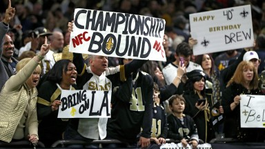 New Orleans Saints fans celebrate their win over the Philadelphia Eagles