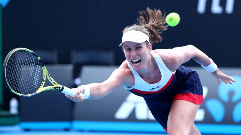 Johanna Konta reaches wide to play a forehand in her first round victory over Ajla Tomljanovic