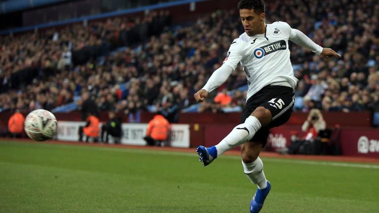 Wayne Routledge of Swansea fires a shot on Aston Villa
