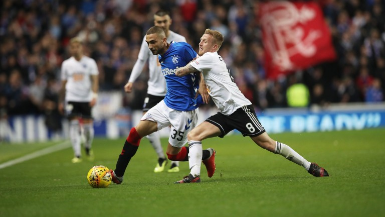 Robbie Crawford of Ayr (right) vies with Eros Grezda of Rangers