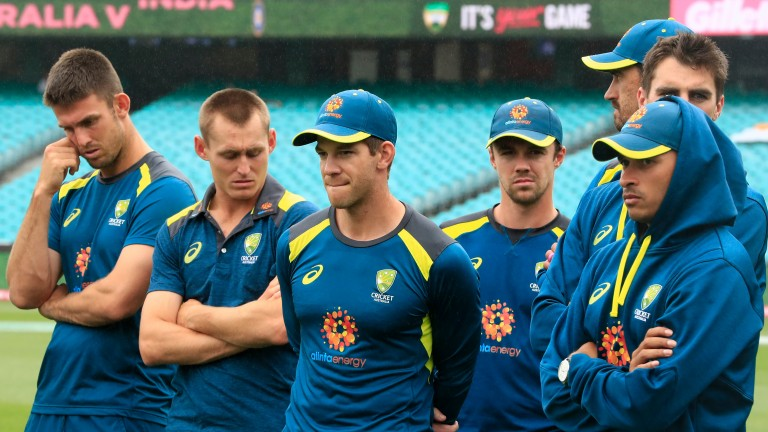 Captain Tim Paine (centre) and his Australia teammates reflect on their Test series defeat to India