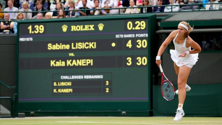 Sabine Lisicki serves at Wimbledon