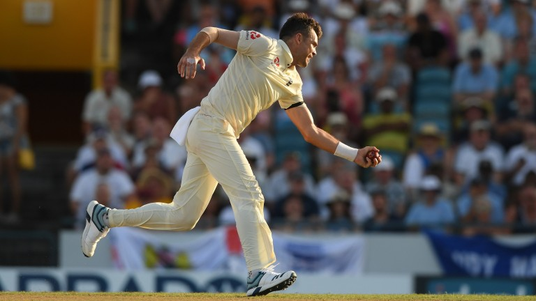 James Anderson claims a sharp catch off his own bowling to dismiss Jason Holder