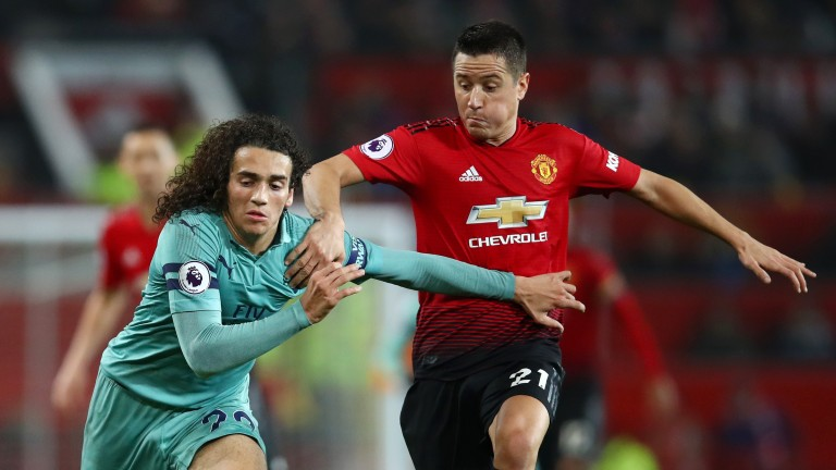 Arsenal's Matteo Guendouzi (left) and Ander Herrera of Manchester United (right) tussling in their Premier League clash at Old Trafford