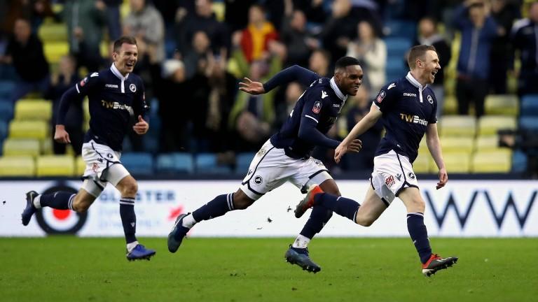 Millwall celebrate Shane Ferguson's goal against Hull in the third round