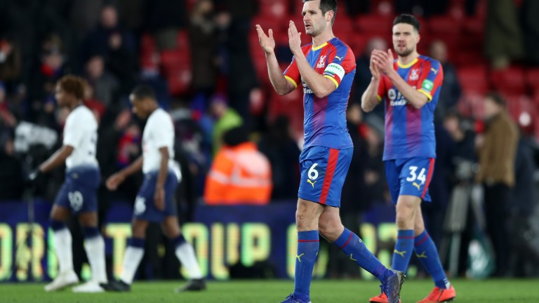 Scott Dann and Martin Kelly clap the Crystal Palace fans after their cup win over Tottenham Hotspur