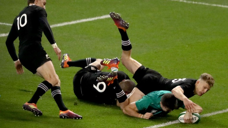 Ireland's Jacob Stockdale scores a try despite the efforts of All Blacks Aaron Smith and Damian McKenzie