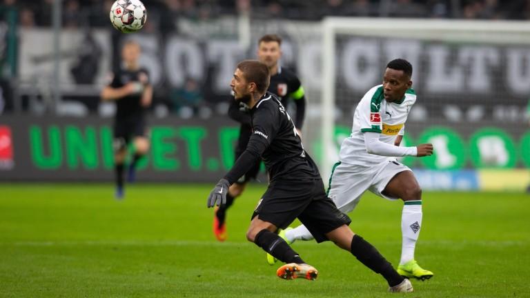 Konstantinos Stafylidis of Augsburg takes the ball away from Monchengladbach's Ibrahima Traore
