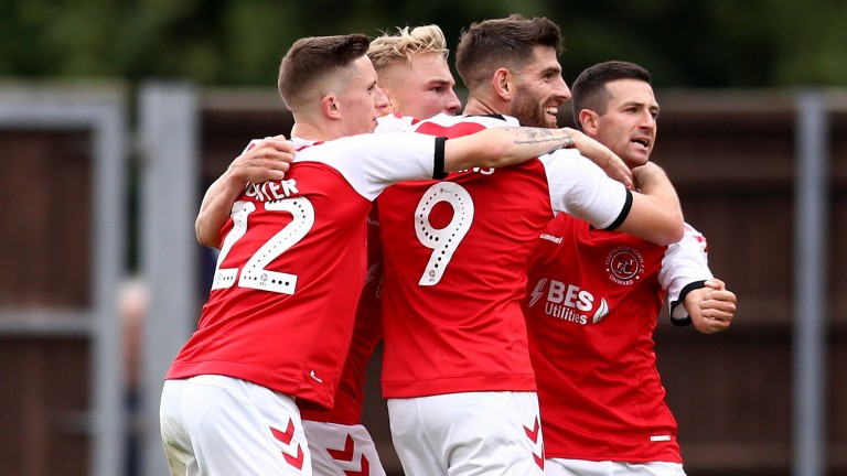 Fleetwood Town celebrate a goal from Ched Evans