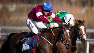 Commander Of Fleet (blue cap) gets the better of Rhinestone in the Grade 1 Nathaniel Lacy & Partners Solicitors 50,000 Cheltenham Bonus For Stable Staff Novice Hurdle at Leopardstown