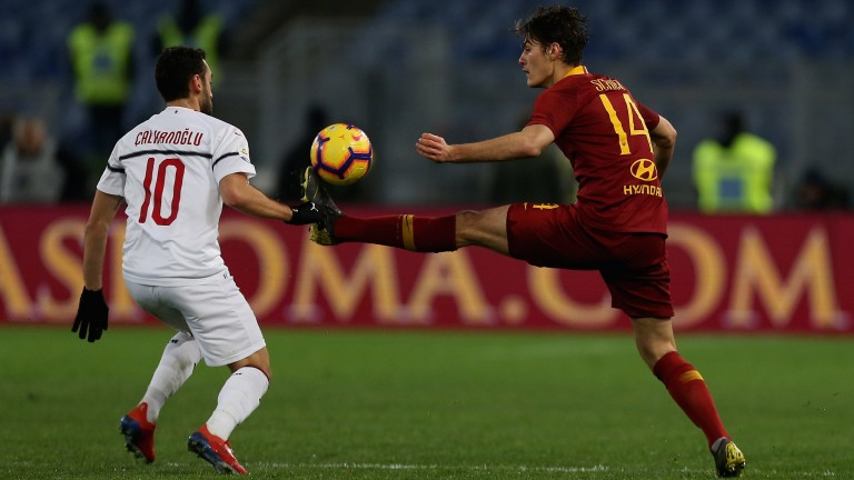 Roma's Patrick Schick (right) competes for the ball with Hakan Calhanoglu of Milan