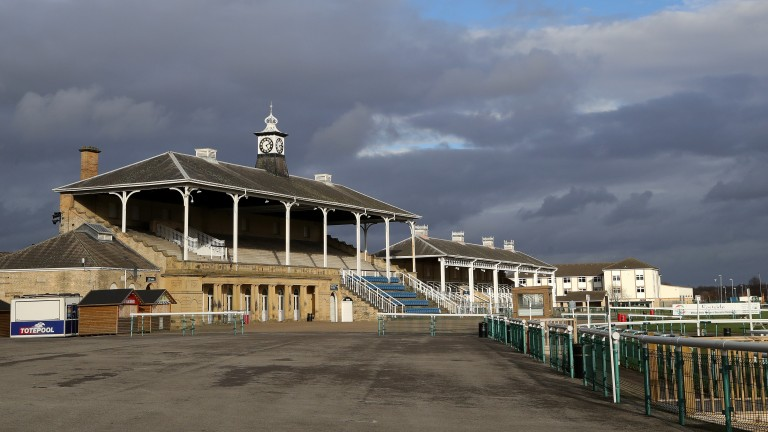 Storm clouds over an empty Doncaster on Thursday summing up a difficult day for racing