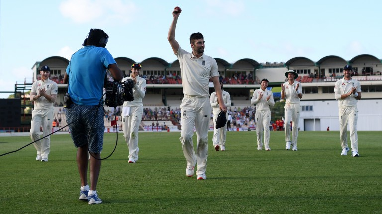 Mark Wood celebrates the first five-wicket haul of his Test career