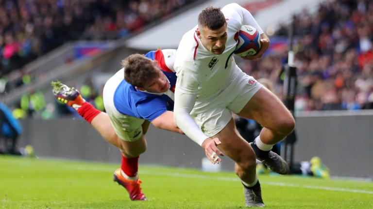 England winger Jonny May scores the second of this three tries against France
