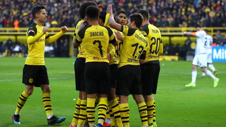 Borussia Dortmund celebrate a goal from Raphael Guerreiro