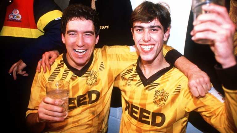 Sutton United's Tony Rains and Matthew Hanlan celebrate after their 1989 FA Cup victory over Coventry City at Gander Green Lane