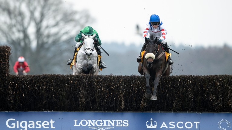 Clan Des Obeaux (right) jumps the last fence and beats Terrefort in the Denman Chase