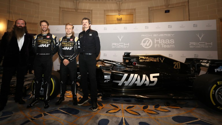 Rich Energy CEO William Storey, drivers Romain Grosjean and Kevin Magnussen and Haas F1 Team Principal Guenther Steiner with their 2019 car