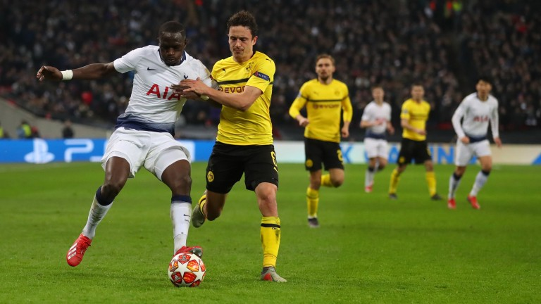 Tottenham's Moussa Sissoko battles with Thomas Delaney of Dortmund the Champions League Round of 16