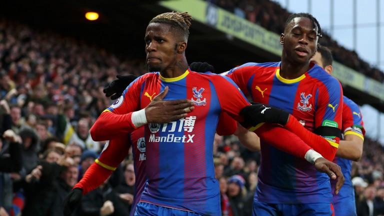 Wilfried Zaha (left) celebrates scoring Crystal Palace's equaliser against West Ham