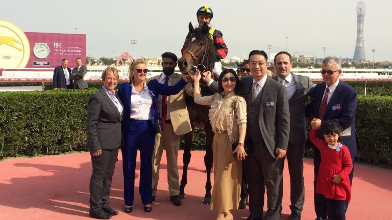 Global Spectrum surrounded by connections after winning the Al Biddah Mile at Al Rayyan