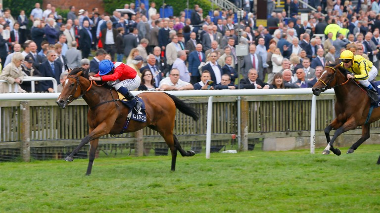 Integral (left) carries the familiar Cheveley Park Stud silks to success in the 2014 Falmouth Stakes
