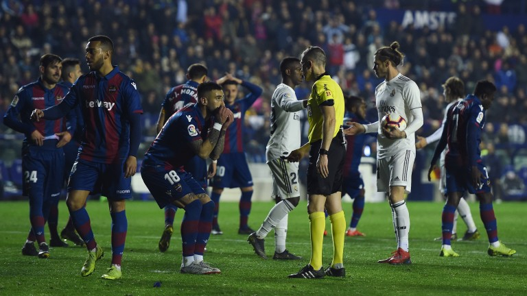 Levante players protest to the referee after Real Madrid were awarded a penalty on Sunday
