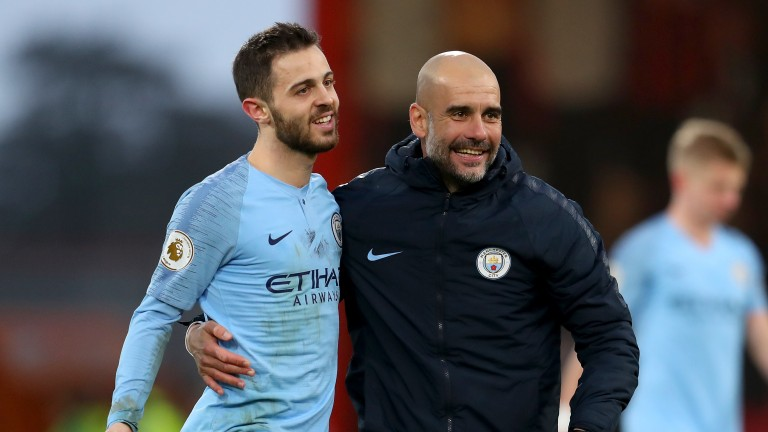 Pep Guardiola embraces Bernardo Silva at Bournemouth