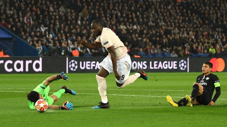 Manchester United's Romelu Lukaku goes past PSG goalkeeper Gianluigi Buffon