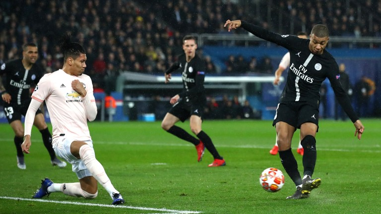 PSG livewire Kylian Mbappe shoots towards Chris Smalling of Manchester United