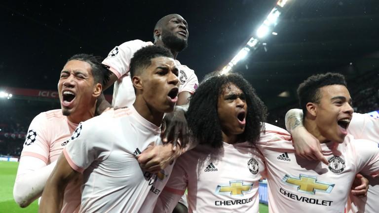 Marcus Rashford celebrates scoring Manchester United's winning goal against PSG
