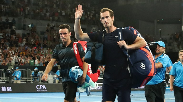 Andy Murray (right) walks off court after his Australian Open loss against Roberto Bautista Agut