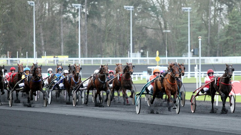 """Cinders and ashes: the climax of a race at France's """"Temple of Trotting,"""" Vincennes on the eastern edge of Paris."""