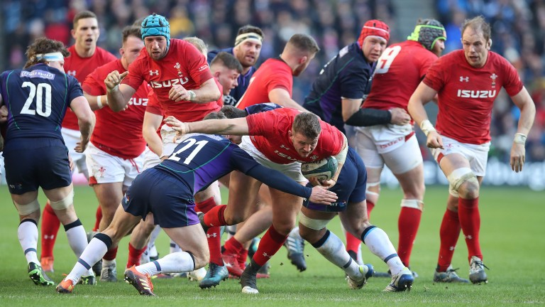 Wales hooker Elliot Dee drives through a tackle against Scotland