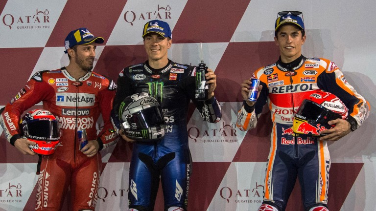 Maverick Vinales (centre) starts on pole position in Qatar ahead of Andrea Dovizioso (left) and Marc Marquez