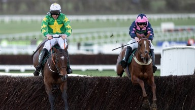 Le Breuil and Jamie Codd (right) win the National Hunt Chase ahead of Discorama (left)