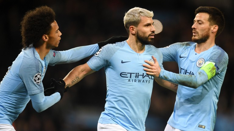 Sergio Aguero (centre) celebrates with Leroy Sane and David Silva after striking City's opener