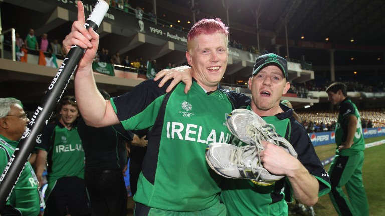 Kevin O'Brien (left) celebrates Ireland's 2011 win over England with his brother Niall