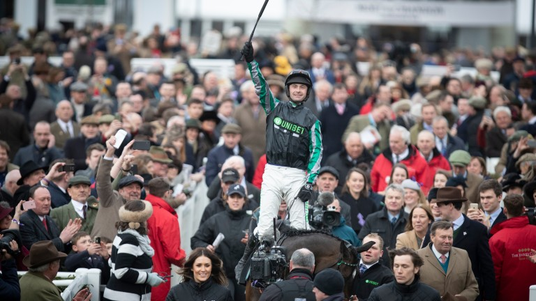 Nico de Boinville is triumphant aboard Altior after the Champion Chase