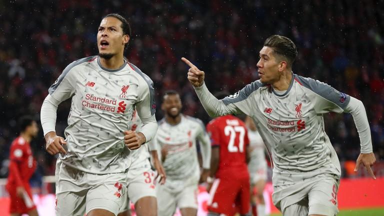 Liverpool's Virgil van Dijk celebrates with Roberto Firmino