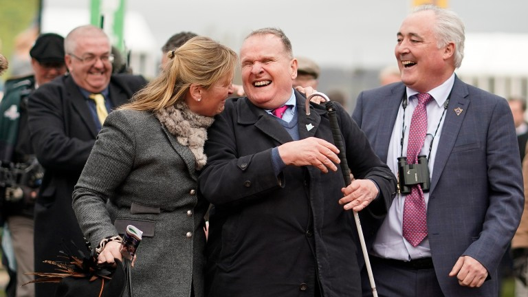 Andrew Gemmell is embraced by Emma Lavelle after Paisley Park's Cheltenham Festival triumph