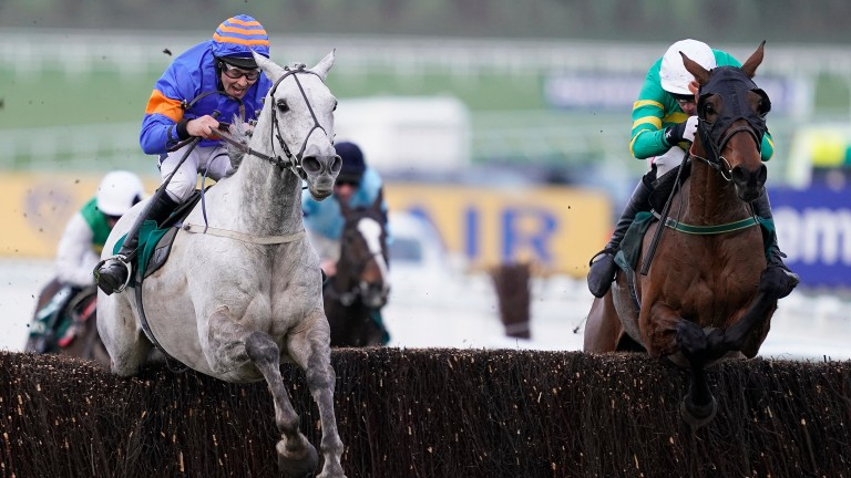 Any Second Now (right) hits the front on his way to winning the Kim Muir at Cheltenham