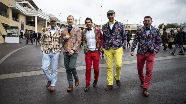 A colourful group of racing fans arrive at Prestbury Park for Gold Cup day