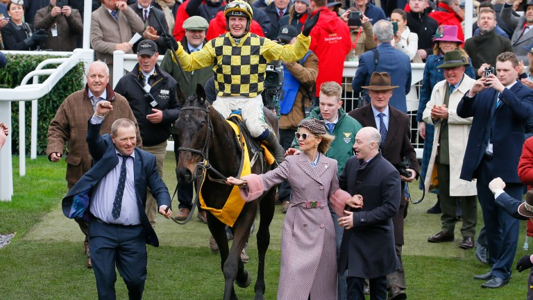 Al Boum Photo and Paul Townend are led into the winner's enclosure after winning the Gold Cup
