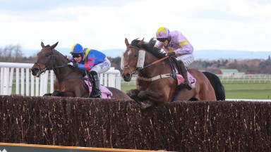 Takingrisks (right) jumps a fence en route to victory in the veterans' chase