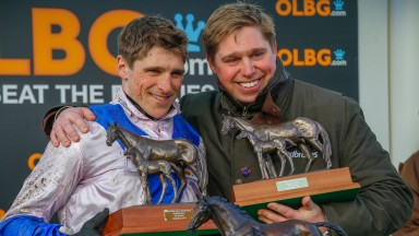 Dan Skelton celebrates with brother Harry (left) after Cheltenham Festival success with Roksana in the OLBG Mares' Hurdle