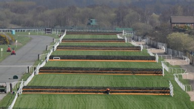Aintree's Grand National course: jockeys will have to walk the track if they have not ridden over these fences twice