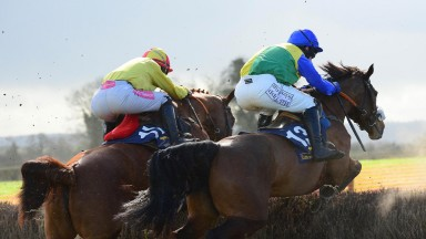 Rose Of Aghaboe (right) and Pa King jump the third-last to win the mares' maiden