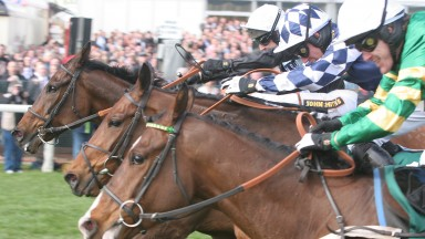 Noel Fehily (centre) gets the better of a close finish with Richard Johnson (far side) and Tony McCoy